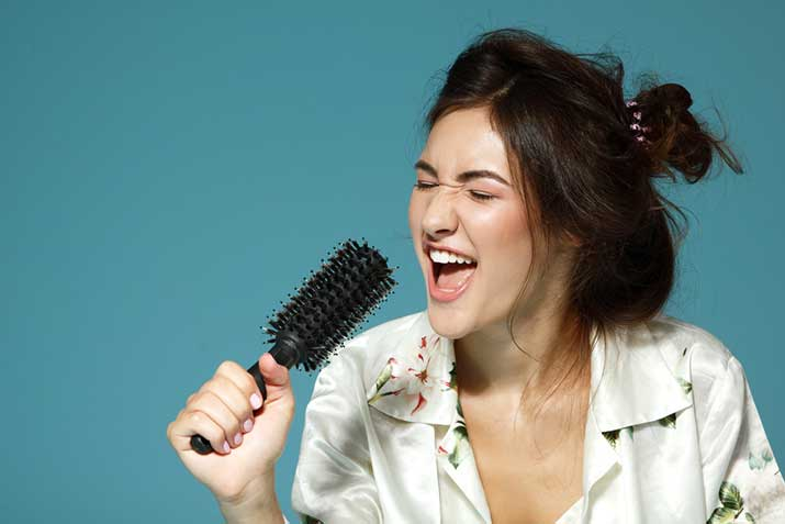 female singing hairbrush